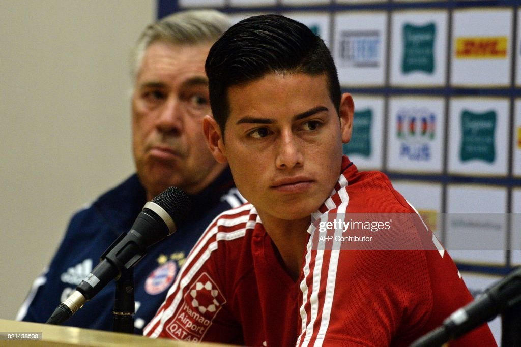 Bayern Munich's midfielder James Rodriguez (R) and head coach Carlo Ancelotti attend a pre-match press conference in Singapore on July 24, 2017, ahead of the International Champions Cup football match between Bayern Munich and Chelsea on July 25. /