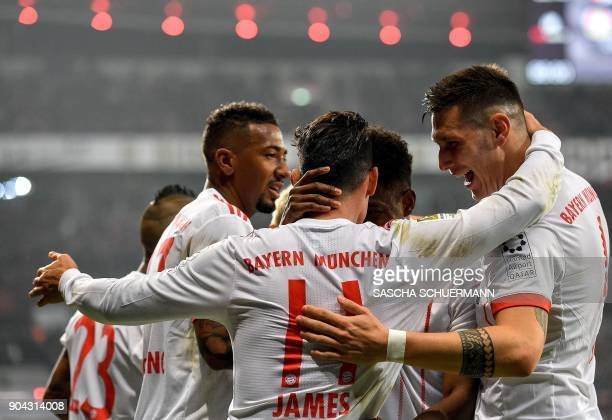 Bayern Munich's midfielder James Rodriguez celebrates after scoring with his teammates during the German First division Bundesliga football match...