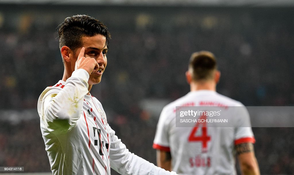 Bayern Munich's midfielder James Rodriguez celebrates after scoring during the German First division Bundesliga football match Bayer Leverkusen vs FC Bayern Munich on January 12, 2018 in Leverkusen, western Germany. /