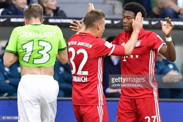 Bayern Munich's midfielder Joshua Kimmich and Bayern Munich's Austrian defender David Alaba celebrate during the German first division Bundesliga...