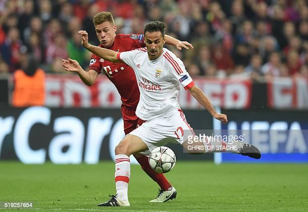 Bayern Munich's midfielder Joshua Kimmich and Benfica's Brazilian forward Jonas vie for the ball during the Champions League quarterfinal firstleg...