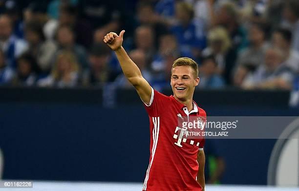 Bayern Munich's midfielder Joshua Kimmich celebrates scoring the 02 goal during the German first division Bundesliga football match between Schalke...