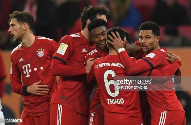 Bayern Munich's midfielder Leon Goretzka Bayern Munich's defender Mats Hummels Bayern Munich's Austrian defender David Alaba Bayern Munich's Spanish...
