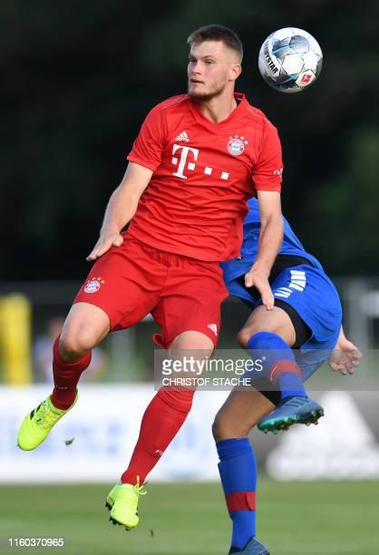 Bayern Munich's midfielder Lukas Mai and RottachEgern's Samet Yilmazer vie for the ball during the preseason friendly football match between FC...