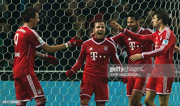 Bayern Munich's midfielder Mario Goetze celebrates after scoring the seventh goal during the German first division Bundesliga football match between...