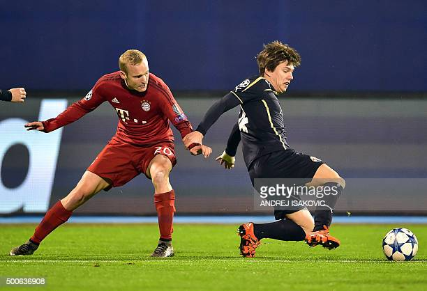 Bayern Munich's midfielder Sebastian Rode vies with Dinamo Zagreb's midfielder Ante Coric during the UEFA Champions League football match between...