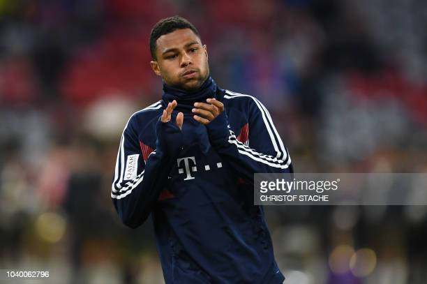 Bayern Munich's midfielder Serge Gnabry arrives for the warm up prior the German first division Bundesliga match between FC Bayern Munich and FC...