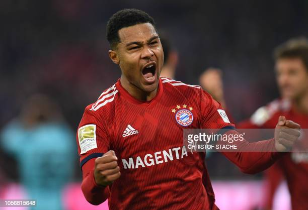 Bayern Munich's midfielder Serge Gnabry celebrates after scoring during the German first division Bundesliga match between FC Bayern Munich and SC...