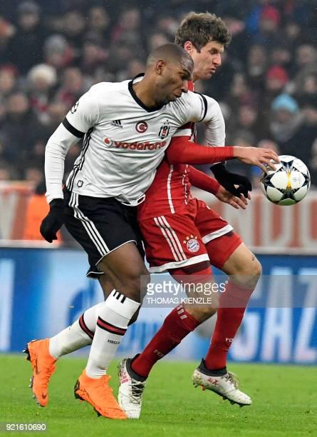 Bayern Munich's midfielder Thomas Mueller and Besiktas' Dutch midfielder Ryan Babel vie with the ball during the UEFA Champions League round of...