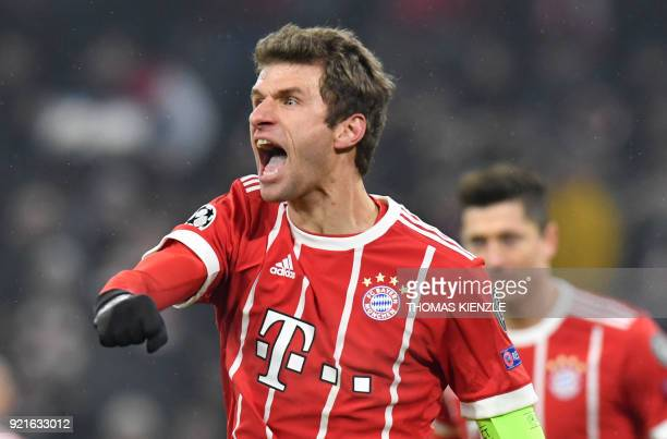 Bayern Munich's midfielder Thomas Mueller celebrates after he scored a second goal during the UEFA Champions League round of sixteen first leg...