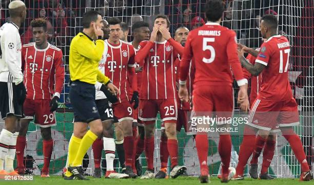 Bayern Munich's midfielder Thomas Mueller celebrates after he scored during the UEFA Champions League round of sixteen first leg football match...
