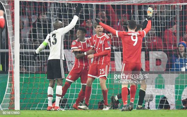 Bayern Munich's midfielder Thomas Mueller celebrates with Bayern Munich's Austrian defender David Alaba after he scored during the UEFA Champions...