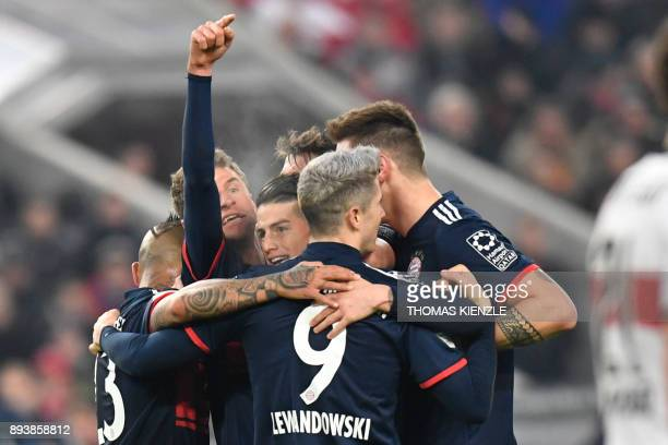 Bayern Munich's midfielder Thomas Mueller celebrates with teammates after he scored during the German first division Bundesliga football match...
