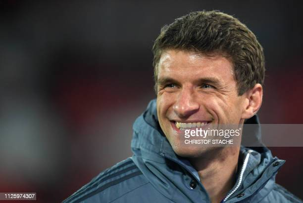 Bayern Munich's midfielder Thomas Mueller laughs prior the UEFA Champions League round of 16 first leg football match between Liverpool and Bayern...