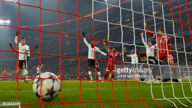 Bayern Munich's midfielder Thomas Mueller scores a goal during the UEFA Champions League round of sixteen first leg football match Bayern Munich vs...