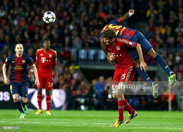 Bayern Munich's midfielder Thomas Mueller vies with Barcelona's Cameroonian midfielder Alex Song during the UEFA Champions League semifinal second...