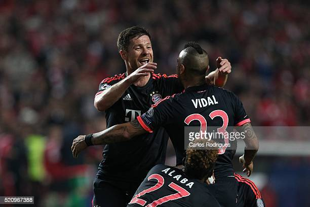 Bayern Munich's midfielder Xabi Alonso and Bayern Munich's defender Arturo Vidal celebrates Bayern«s first goal score by Bayern Munich's defender...