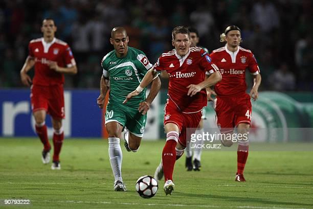 Bayern Munich's mildfielder Bastian Schweinsteiger vies with Maccabi Haifa forward Yaniv Katan during their UEFA Champions League round match on...