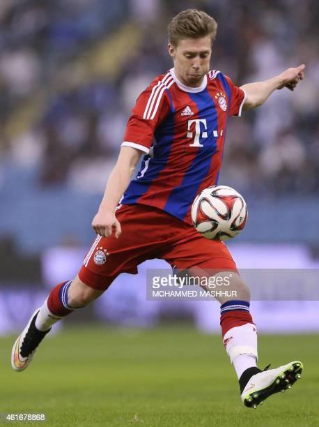 Bayern Munich's Mitchell Weiser dribbles during their friendly football match against Saudi's Al-Hilal club at the King Fahad Stadium in Riyadh on...