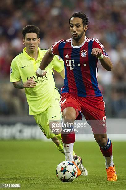 Bayern Munich's Moroccan defender Medhi Benatia and Barcelona's Argentinian forward Lionel Messi vie for the ball during the UEFA Champions League...