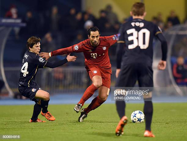 Bayern Munich's Moroccan striker Medhi Benatia vies with Dinamo Zagreb's midfielder Ante Coric during the UEFA Champions League football match...
