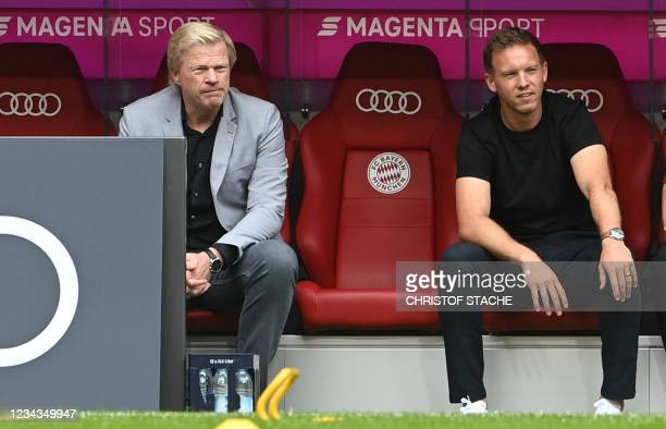 Bayern Munich's new CEO Oliver Kahn and Bayern Munich's new coach Julian Nagelsmann sit bench prior the Audi Summer Tour 2021 football match FC...