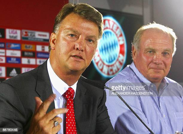 Bayern Munich's new coach Louis van Gaal addresses a press conference as Bayern Munich manager Uli Hoeness looks on after their team's first training...