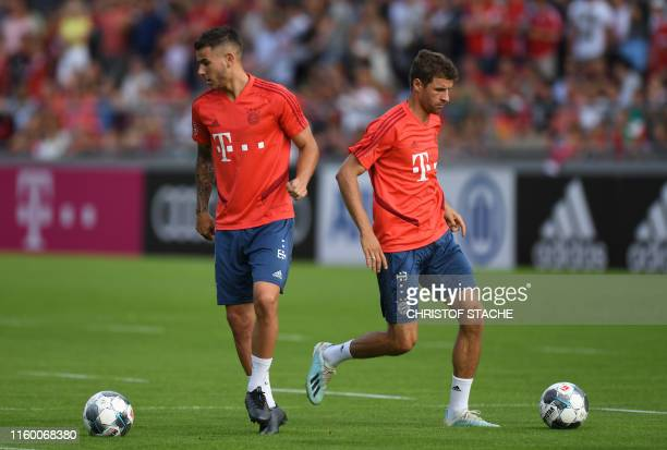 Bayern Munich's new French defender Lucas Hernandez and Bayern Munich's striker Thomas Mueller play the ball during the first session of the training...