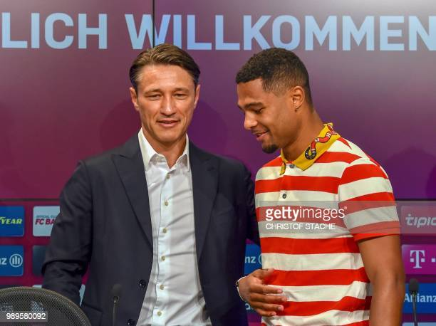 Bayern Munich's new head coach Croatian Niko Kovac and midfielder Serge Gnabry pose during a press conference in the stadium in Munich southern...