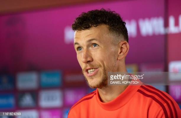 Bayern Munich's new recruit, Croatian midfielder Ivan Perisic, attends a press conference during his presentation at Bayern Munich's headquarters in...