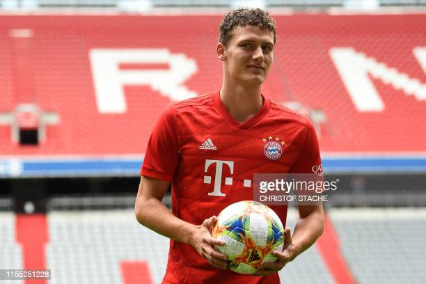Bayern Munich's newly-recruited French defender Benjamin Pavard poses with a ball after his official presentation on July 12, 2019 in Munich,...