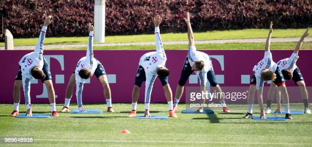 Bayern Munich's Niklas Suele Marco Friedl Sandro Wagner Tom Starke Felix Goetze and Sebastian Rudy participate in a training session in Doha Qatar 4...