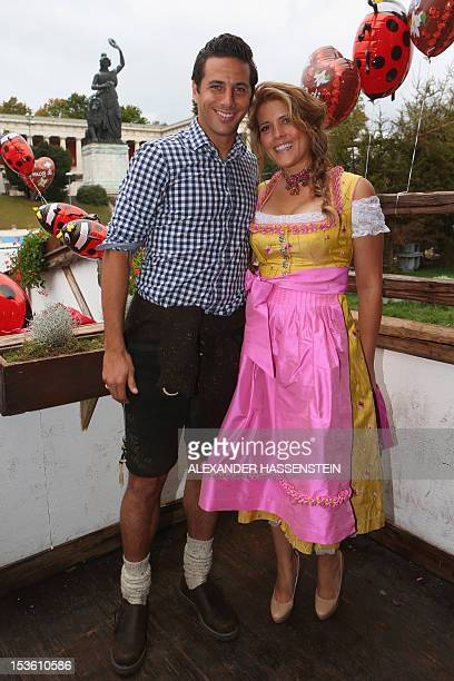 Bayern Munich's Peruvian striker Claudio Pizarro and attends with wife Karla Salcedo pose for photographers during the traditional visit by German...