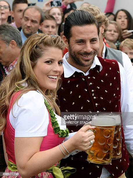 Bayern Munich's Peruvian striker Claudio Pizarro and his wife Karla Salcedo arrive for the traditional visit of German first division football club...