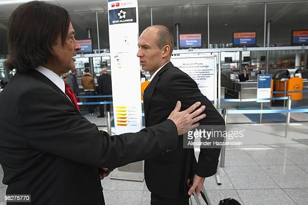 Bayern Munich's player Arjen Robben talks to his team doctor HansWilhelm MuellerWohlfahrt prior to their departure at the Munich Airport on April 6...