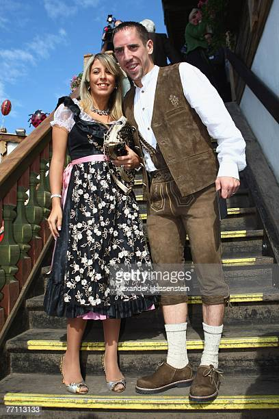 Bayern Munichs player Frank Ribery arrives with his wife Wahiba Ribery at the Kaefers party tent for a day at the Oktoberfest on September 30 2007 in...
