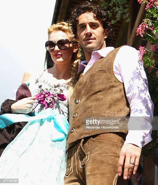 Bayern Munichs player Luca Toni arrives with his wife Marta Cecchetto at the Kaefers party tent for a day at the Oktoberfest on September 30 2007 in...