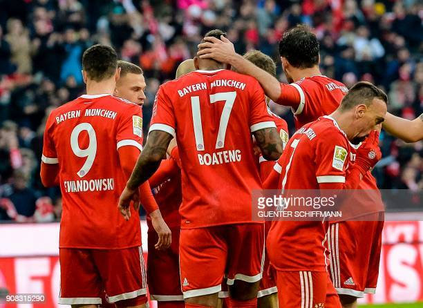 Bayern Munich's players celebrate after German forward Thomas Mueller scored a goal during the German first division Bundesliga football match Bayern...