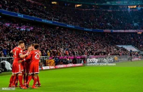 Bayern Munich's players celebrate after Polish striker Robert Lewandowski scored a goal during the German first division Bundesliga football match...