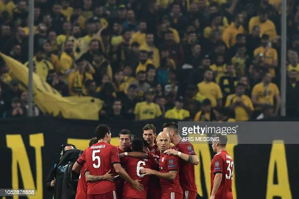 Bayern Munich's players celebrate after scoring their second goal during the UEFA Champions League football match between AEK Athens FC and FC Bayern...