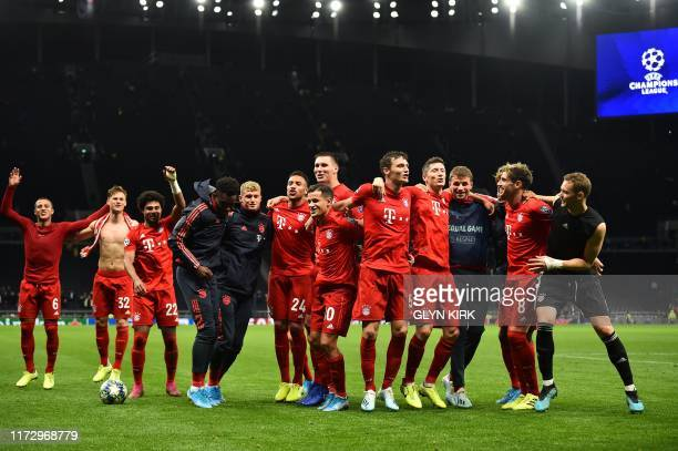 Bayern Munich's players celebrate on the pitch after the UEFA Champions League Group B football match between Tottenham Hotspur and Bayern Munich at...