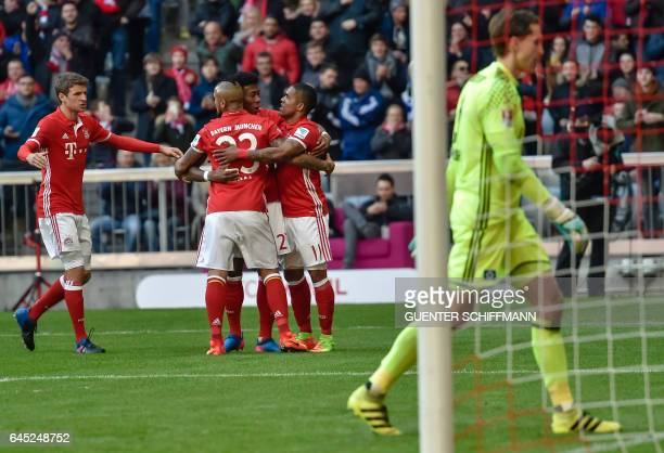 Bayern Munich's players celebrate the first goal during the German first division Bundesliga football match between Bayern Munich and Hamburger SV in...