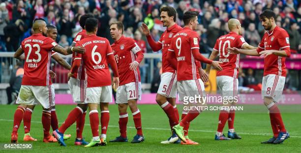 Bayern Munich's players celebrate their fith goal during the German first division Bundesliga football match between Bayern Munich and Hamburger SV...