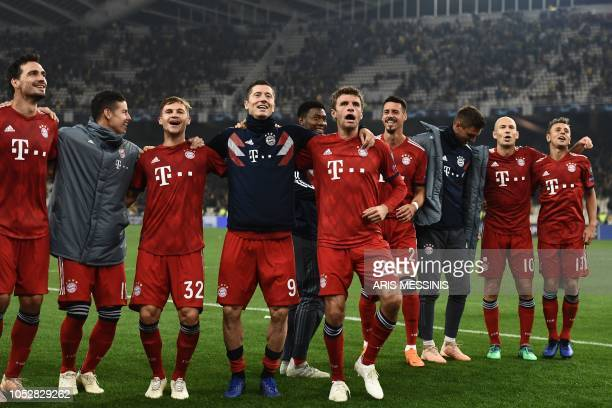 Bayern Munich's players celebrate their victory over Athens at the end of the UEFA Champions League football match between AEK Athens FC and FC...