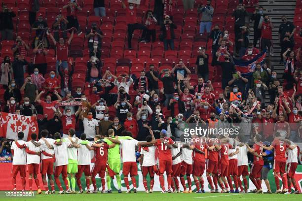 Bayern Munich's players celebrate with suporters after winning the UEFA Super Cup football match between FC Bayern Munich and Sevilla FC at the...