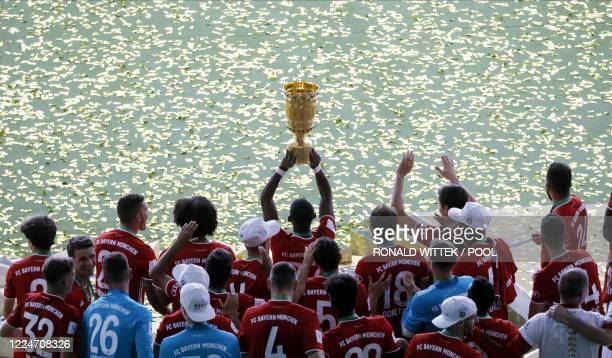 Bayern Munich's players celebrate with the German Cup trophy after winning the final football match Bayer 04 Leverkusen v FC Bayern Munich at the...