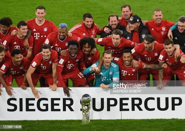 Bayern Munich's players celebrate with the trophy after winning the German Supercup football match FC Bayern Munich v BVB Borussia Dortmund in...