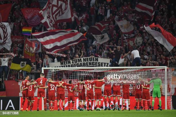 Bayern Munich's players celebrate with their fans after the UEFA Champions League quarterfinal second leg football match between FC Bayern Munich and...