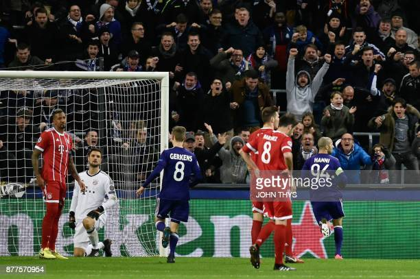 Bayern Munich's players react after Anderlecht's Algerian midfielder Sofiane Hanni scored a goal during the UEFA Champions League Group B football...