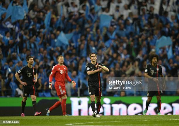 Bayern Munich's players Spanish midfielder Xabi Alonso goalkeeper Manuel Neuer defender Philipp Lahm and Brazilian defender Dante react to FC Porto'...